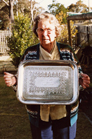 Florence Walters, daughter of William and Johanna Lyons, holds the silver plated tray presented to Ellen Lyons on leaving Marong, 4 April 1912