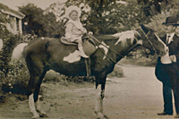 Herbert Bowen on horse at Ellendale lead by his father George Bowen, probably about 1903/04